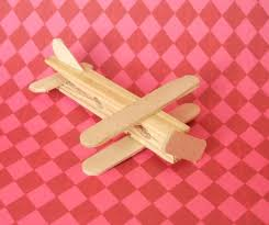 wooden airplane make with traditional clothespin spring removed