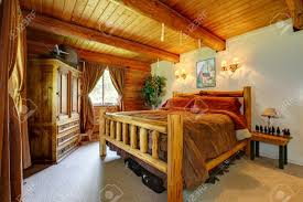 cowboy western bedroom interior with wood ceiling stock photo