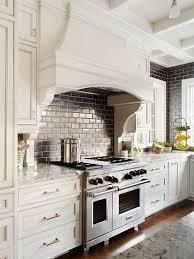 backsplash for cream cabinets black subway tile transitional kitchen bhg