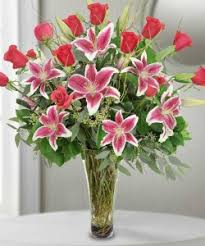 stargazer lilies stargazer lilies roses vase arrangement in fort smith ar
