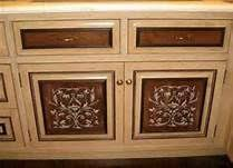 kitchen stencil ideas how to use a stencil to emboss on cabinet doors for a carved look