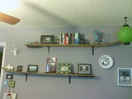 wooden water skis turned into wall shelves just mount with