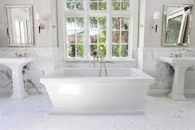 traditional bathroom floor tile herringbone floor tile bathroom traditional with gold chandelier