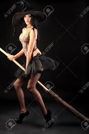 halloween witch background charming halloween witch with broom over black background stock