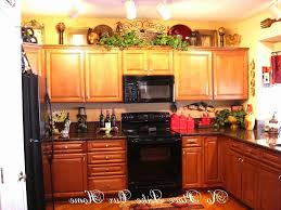 top of kitchen cabinet decor ideas decorations on top of kitchen cabinets ideas for decorating on top