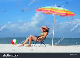 Beach Sun Umbrella Sitting On Beach Chair Under Stock Photo 17028157 Shutterstock