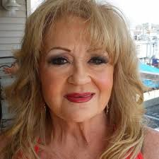 layered hairstyles with bangs and tuck behind the ears 50 age defying hairstyles for women over 60 hairstylec