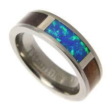 blue titanium wedding band koa wood inlaid men s titanium wedding band with blue green opal