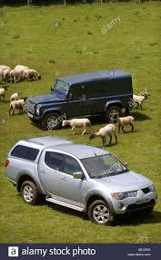 mitsubishi truck a land rover defender and mitsubishi l200 pick up truck on a stock