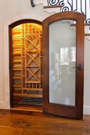 wooden glass door basement breezy trap door wine cellar with glass door and wooden