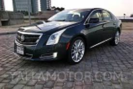 compare cadillac cts and xts compare cars cadillac cts coupe 2012 6 2l awd vs chrysler 300c
