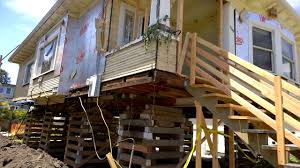 homes on pilings house on stilts this is how they lift houses in america youtube