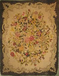 ah me tis florals flourish in antique hooked rugs
