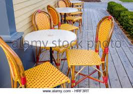 White Plastic Bistro Chairs French Style Metal Table And Chairs Furniture On Stone Patio In