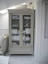 bathroom linen cabinet with glass doors postwar construction meets prewar charm in victoria design sponge