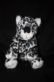 plush snow leopard our singing stuffed animals a box