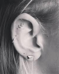 16 tiny ear tattoos that are for minimalists minimalist