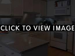 white kitchen with stainless steel backsplash backsplash ideas