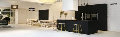 black kitchen with island by santos for the new showroom espacio