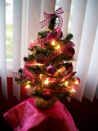 lighted miniature tree with pinecones and