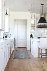 white kitchen cabinets with oak floors becki owens interior design kitchen white oak floors home