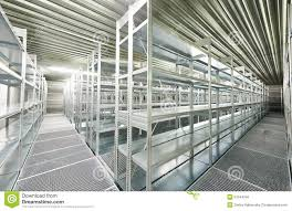 empty new modern shelves in warehouse stock photo image 51544756
