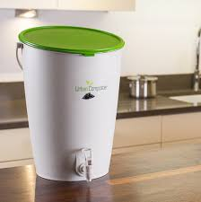 minimalist kitchen design with green countertop compost bin 1