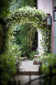 garden arch a simple wooden arch in a garden makes an ideal
