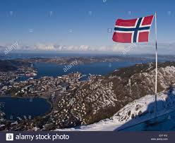 Norweigan Flag Bergen City Norway With A With A Norwegian Flag In The Foreground