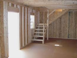looking down stairs from unfinished bonus room above garage