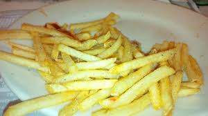 salt and pepper haphazardly sprinkled on top of fries picture
