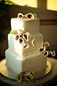 three tier fresh flower wedding cake with calla lily cake topper