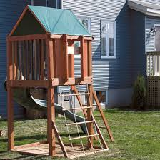 Backyard Forts Kids An Elevated Play Fort Has A Slide Ladder And A Solid Ladder