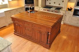 large kitchen island with storage unit underneath and butcher