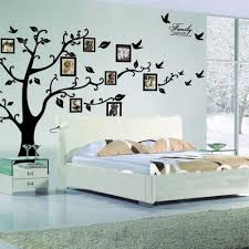 organizing living room family picture ideas midcityeast white bed and nighstands placed beside black tree wall mural and stunning family picture ideas