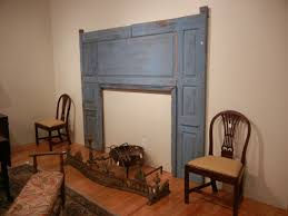 auction decorating a fireplace surround and a mirror cozy and