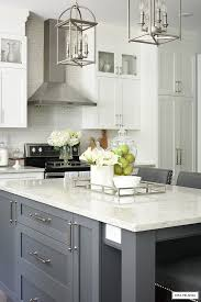 white kitchen cabinets grey island white and grey kitchen a hardware update citrineliving