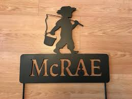 handmade powder coated last name and fishing boy steel sign