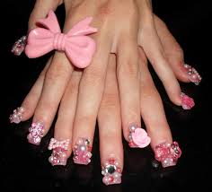 acrylic nails with bows and diamonds beautify themselves with