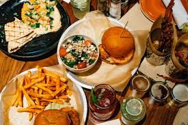 table full of food lazy dog restaurant bar westminster review new denizen