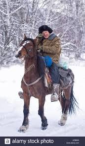 shepherd or cowboy rides in winter snowy forest novemer 1