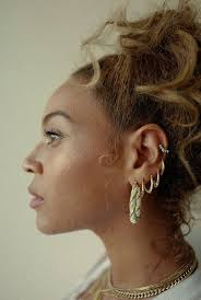beyonce earrings hot or not beyoncé wears ripped vogue t shirt and white x