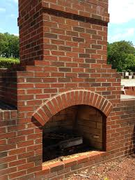 a classic outdoor fireplace constructed out of old colonial style