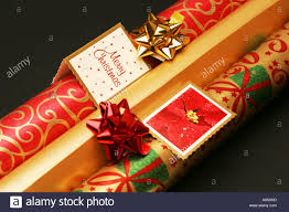 rolls of festive xmas christmas present gift wrap wrapping paper