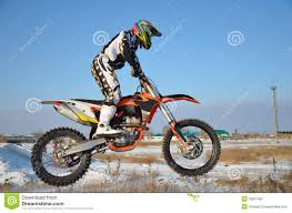bike motocross rider on bike for motocross flies over hill stock photography