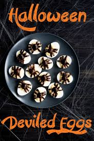 halloween deviled eggs recipe topped with spiders recipe