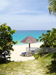 Beach Lounge Chair Umbrella Luxury Beach Scene With Lounge Chairs And Umbrella Stock Photo