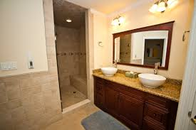 brown stained woooden large vanity bathroom with double sink and
