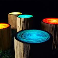 not only do these tree stump lights provide cool outdoor lighting