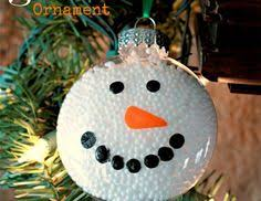 sitting at our kitchen table marshmallow snowman ornament cub